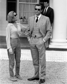 goldfinger_sean_connery_in_sunglasses_and_honor_blackman_on_location_between_takes_2