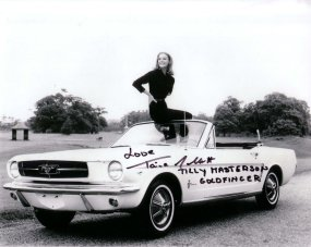 goldfinger_tania_mallet_posing_with_1965_ford_mustang_at_stoke_poges_golf_club_2