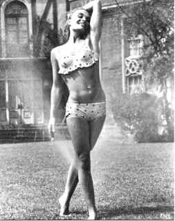 shirley_eaton_frolicking_in_water_from_a_sprinkler
