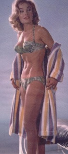 shirley_eaton_taking_off_bathing_robe_to_reveal_bikini