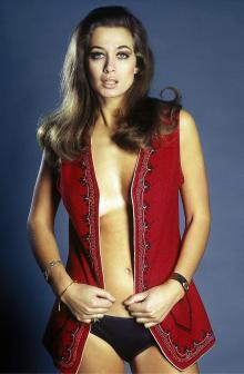 valerie_leon_red_waistcoat_and_black_pants_2