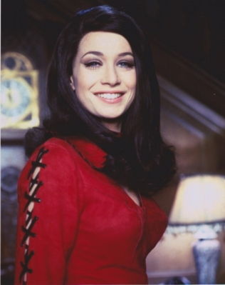 valerie_leon_smiling_in_red_blouse