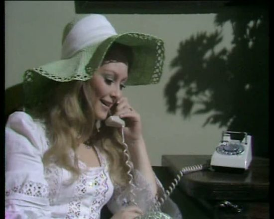 jenny_hanley_in_wide_brimmed_hat_on_the_telephone