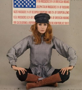 joanna_lumely_with_anti-war_stars_and_stripes_flag
