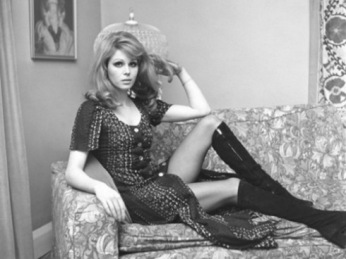 joanna_lumley_reclining_on_settee