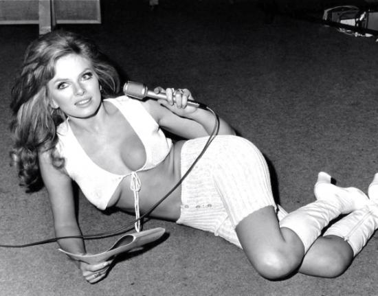 julie_ege_in_white_bikini_suit_holding_microphone