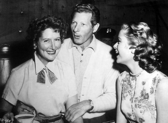 white_christmas_danny_kaye_during_break_in_filming_visits_grace_kelly_with_wardrobe_supervisor_ruth_stella_on_set_of_rear_window
