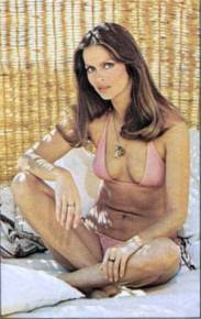 barbara_bach_the_spy_who_loved_me_pink_bikini_in_wicker_chair_2