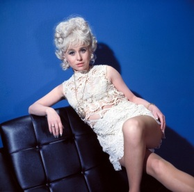 barbara_windsor_posing_on_black_leather_chair