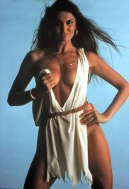 caroline_munro_holding_up_white_dress