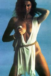 caroline_munro_holding_up_white_dress_2