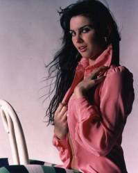 caroline_munro_in_pink_shirt_and_funky_tights