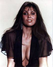 caroline_munro_in_semi-sheer_black_blouse