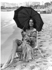 caroline_munro_on_the_beach_with_a_parasol