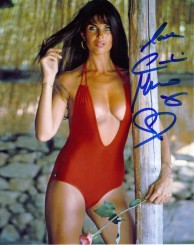 caroline_munro_posing_in_red_swimsuit