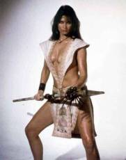 caroline_munro_posing_with_spear