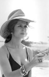 barbara_bach_posing_in_hat_as_she_points_pistol_the_spy_who_loved_me