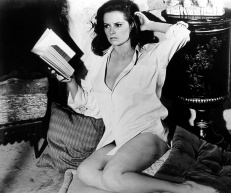 luciana_paluzzi_distracted_from_reading_book