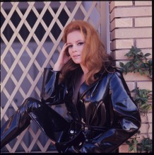 luciana_paluzzi_in_black_pvc_mack_and_trousers