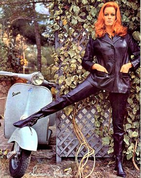 luciana_paluzzi_in_leaths_posing_with_a_vespa_motorbike