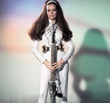 luciana_paluzzi_in_psychedelic_get-up-with_strange_speargun_weapon