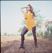 luciana_paluzzi_posing_in_yellow_jumper_and_scarf_and_long_leather_boots