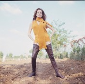luciana_paluzzi_posing_in_yellow_jumper_and_scarf_and_long_leather_boots_2