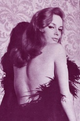 luciana_paluzzi_purple_tint_looking_over_shoulder