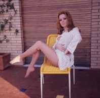 luciana_paluzzi_sitting_on_yellow_seat