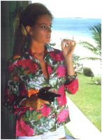 luciana_paluzzi_thunderball_floral_shirt_pistol_and_cigarette_2