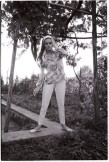 luciana_paluzzi_thunderball_floral_shirt_pistol_and_cigarette_4
