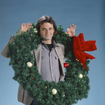 bill_murray_wearing_giant_holly_wreath_early_1980s