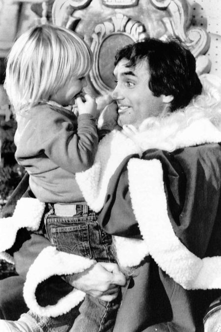 george_best_as_santa_with_his_son_callum_best